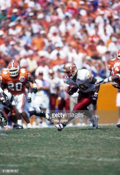 Running back Warrick Dunn of the Florida State Seminoles runs with the ball during an NCAA game against the Clemson Tigers on September 9 1995 at...