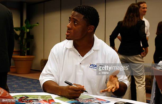 Running back Warrick Dunn of the Tampa Bay Buccaneers participates at the VISA Financial Football Super Bowl at the Tampa Convention Center on...