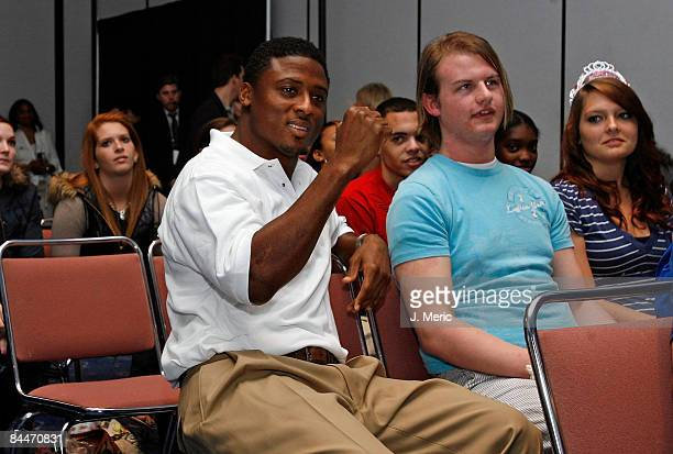 Running back Warrick Dunn of the Tampa Bay Buccaneers participates with local high school students at the VISA Financial Football Super Bowl at the...