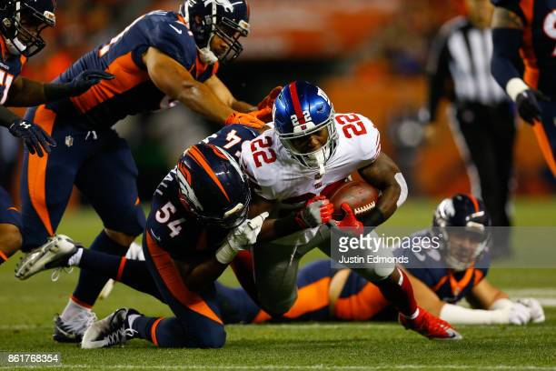Running back Wayne Gallman of the New York Giants is tackled by Inside Linebacker Brandon Marshall of the Denver Broncos after a gain for five yards...