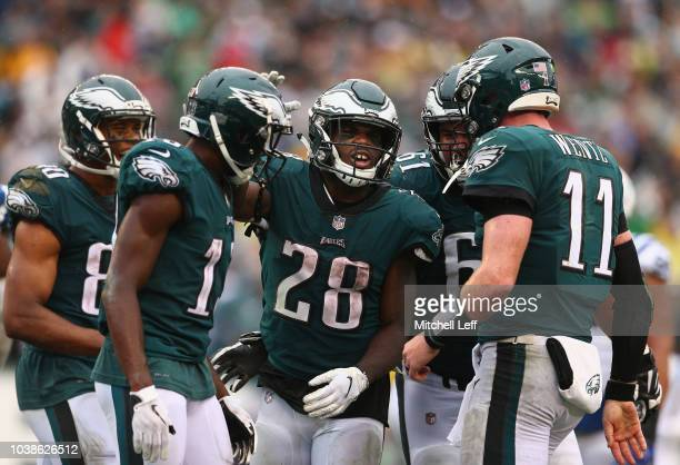 Running back Wendell Smallwood of the Philadelphia Eagles celebrates his gamewinning touchdown with teammates Jordan Matthews wide receiver Nelson...