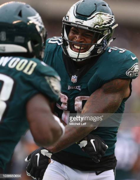 Running back Wendell Smallwood of the Philadelphia Eagles celebrates his gamewinning touchdown with teammate running back Corey Clement against the...