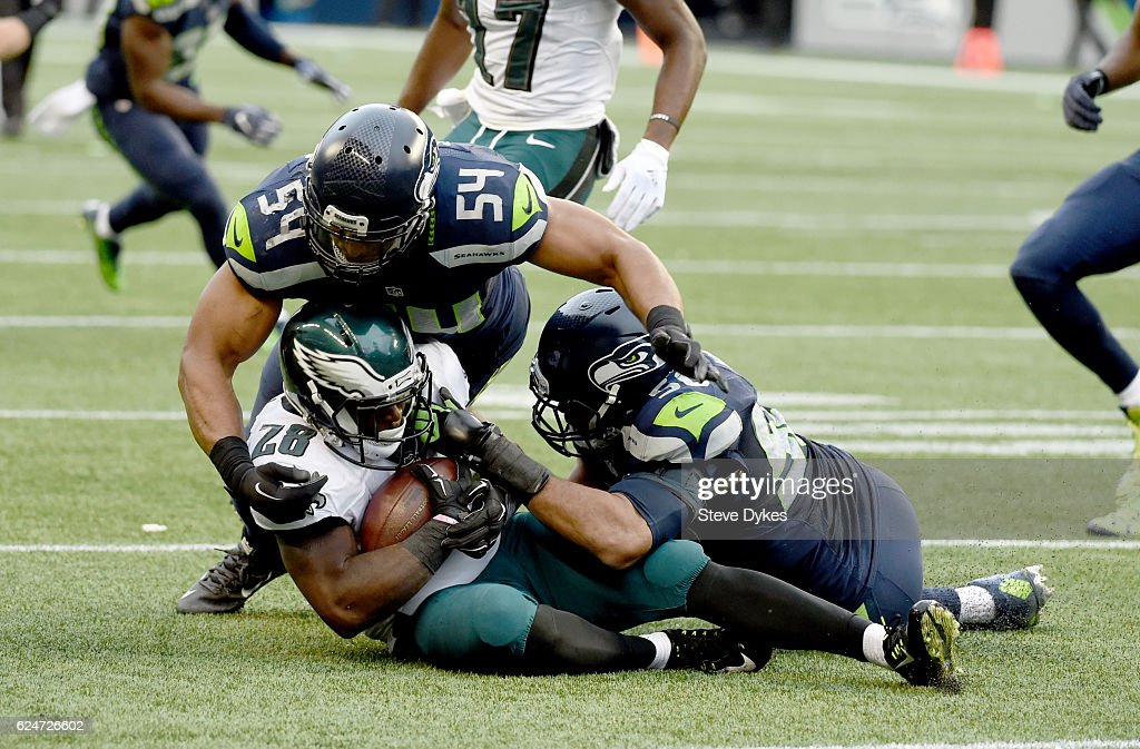 Running back Wendell Smallwood #28 of the Philadelphia Eagles is brought down by the Seattle Seahawks at CenturyLink Field on November 20, 2016 in Seattle, Washington.
