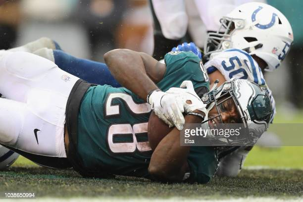 Running back Wendell Smallwood of the Philadelphia Eagles makes a game-winning touchdown against linebacker Anthony Walker of the Indianapolis Colts...