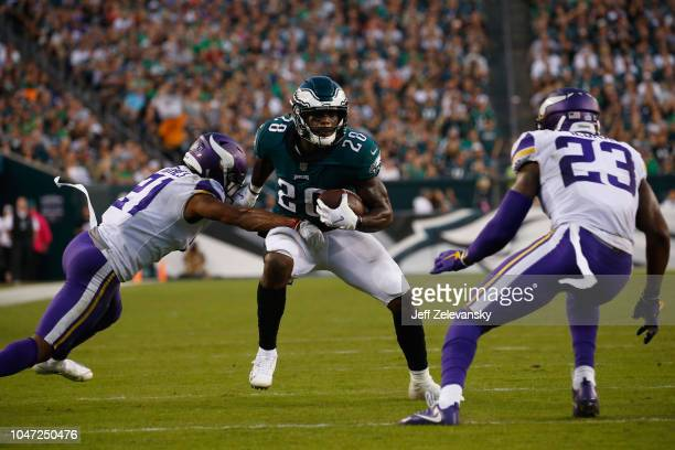 Running back Wendell Smallwood of the Philadelphia Eagles runs the ball against cornerback Mike Hughes and defensive back George Iloka of the...