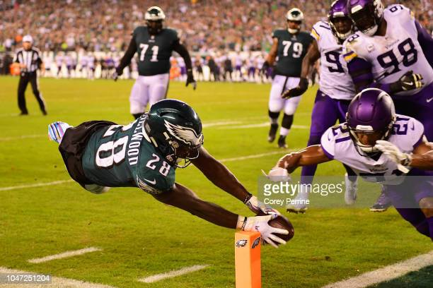 Running back Wendell Smallwood of the Philadelphia Eagles scores a twopoint conversion against cornerback Mike Hughes of the Minnesota Vikings during...
