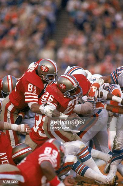 Running back Wendell Tyler and tight end Russ Francis of the San Francisco 49ers block at the line of scrimage against the Miami Dolphins defense...