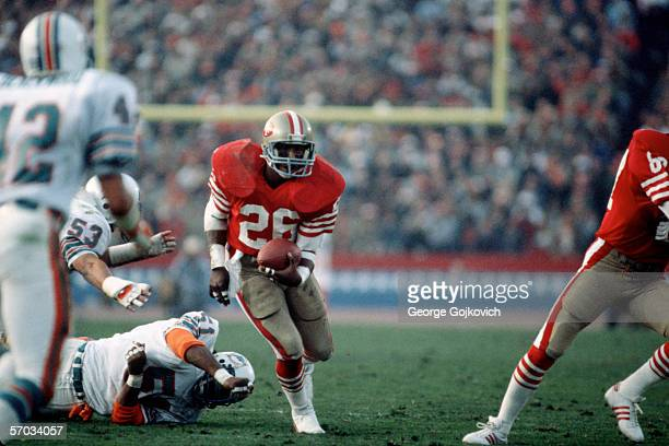 Running back Wendell Tyler of the San Francisco 49ers runs the ball against the Miami Dolphins during Super Bowl XIX at Stanford Stadium on January...
