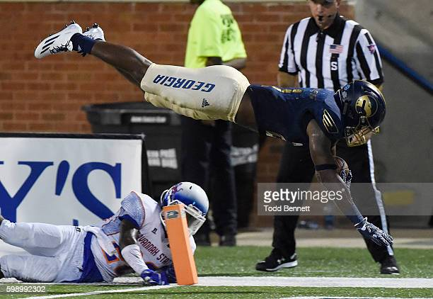 Running back Wesley Fields of the Georgia Southern Eagles is sent airborne into the endzone by cornerback Darrell Bonner of the Savannah State Tigers...