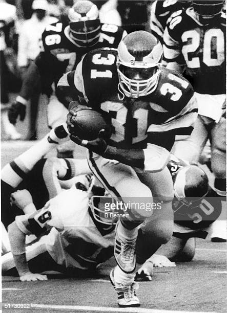 Running back Wilbert Montgomery of the Philadelphia Eagles breaks away from the pack to gain yards during a game against the Washington Redskins on...