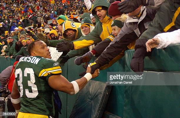 Running back William Henderson of the Green Bay Packers greets fans in the end zone after a game against the Seattle Seahawks on January 4 2004 at...