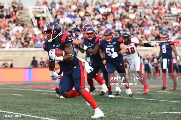 Running back William Stanback of the Montreal Alouettes runs the ball against the Ottawa RedBlacks during the CFL game at Percival Molson Stadium on...