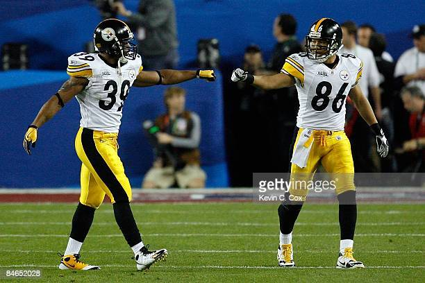 Running back Willie Parker and wide receiver Hines Ward of the Pittsburgh Steelers touch fists against the Arizona Cardinals during Super Bowl XLIII...
