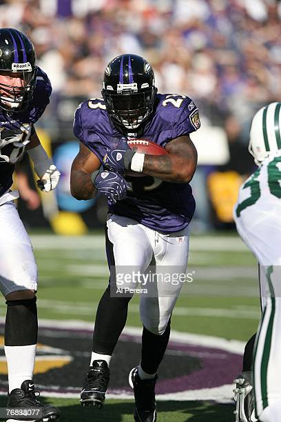Running Back Willis McGahee of the Baltimore Ravens runs through the defense of the New York Jets at M&T Bank Stadium on September 16, 2007 in...
