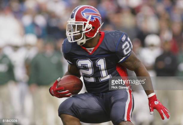 Running back Willis McGahee of the Buffalo Bills runs upfield against the New York Jets during the game on November 7 2004 at Ralph Wilson Stadium in...