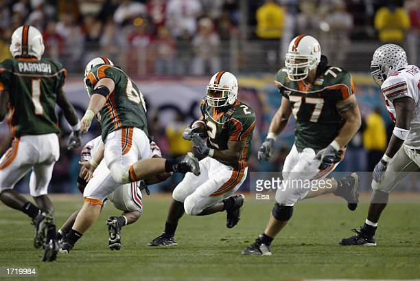 Running back Willis McGahee of the Miami Hurricanes follows his blockers against the Ohio State Buckeyes in the Tostitos Fiesta Bowl on January 3...