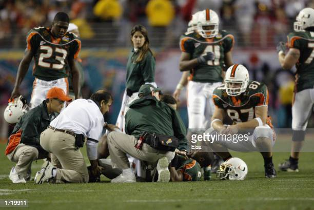 Running back Willis McGahee of the Miami Hurricanes lies on the field after being injured by the Ohio State Buckeyes defense during the Tostitos...