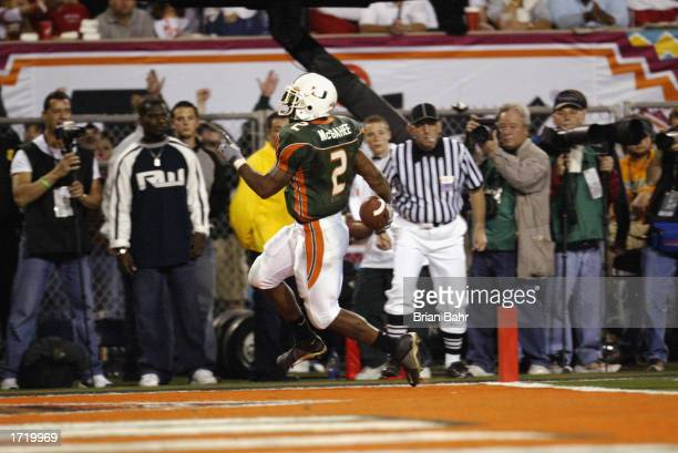 Running back Willis McGahee of the University of Miami Hurricanes runs in for a touchdown against Ohio State Buckeyes in the Tostitos Fiesta Bowl at...