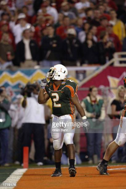 Running back Willis McGahee of the University of Miami Hurricanes quiets the Ohio State Buckeyes fans after scoring the team's second touchdown...