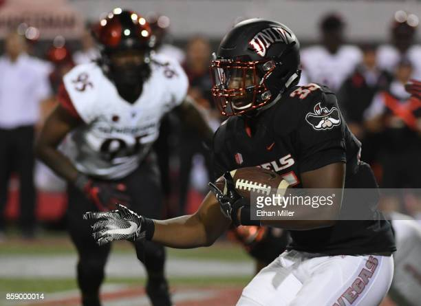 Running back Xzaviar Campbell of the UNLV Rebels runs for yardage against the San Diego State Aztecs during their game at Sam Boyd Stadium on October...