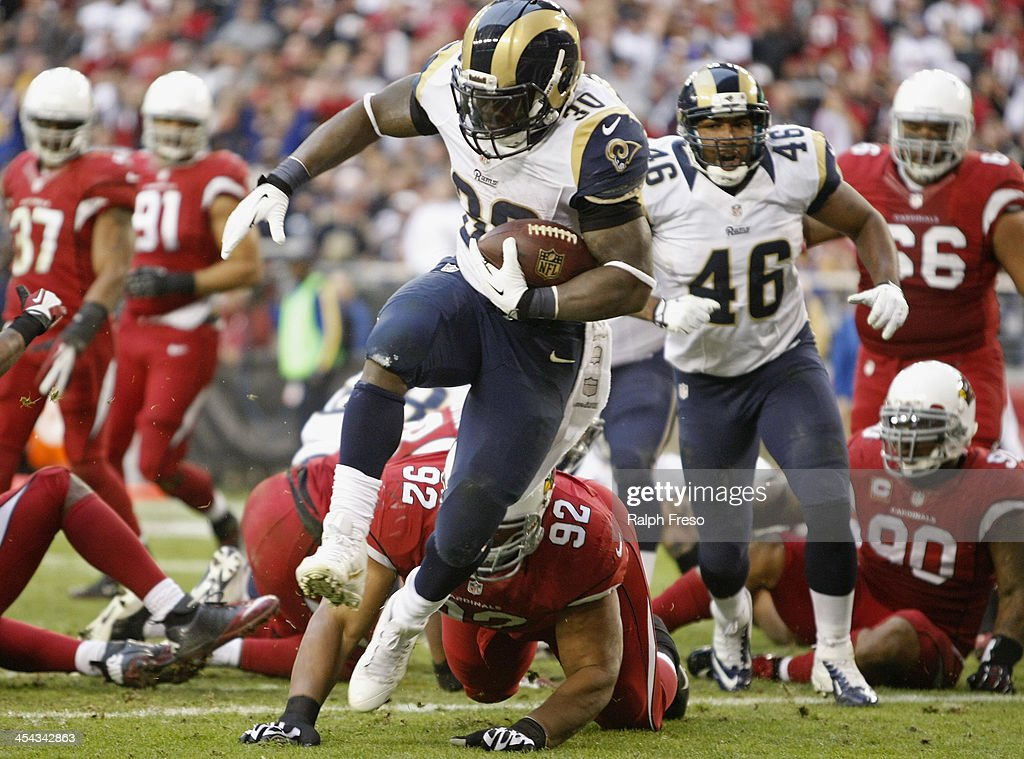Running back Zac Stacy #30 of the St Louis Rams high steps into the endzone for a touchdown past Dan Williams #92 of the Arizona Cardinals during the fourth quarter of their NFL football game at University of Phoenix Stadium on December 8, 2013 in Glendale, Arizona.