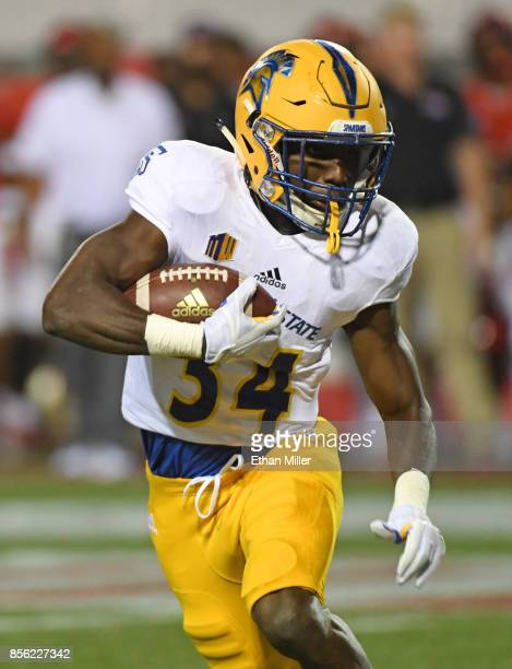 Running back Zamore Zigler of the San Jose State Spartans runs against the UNLV Rebels during their game at Sam Boyd Stadium on September 30 2017 in...