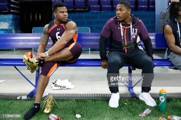 Running backs Damien Harris and Josh Jacobs of Alabama look on during day two of the NFL Combine at Lucas Oil Stadium on March 1, 2019 in...