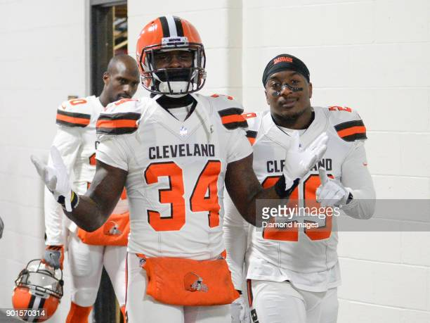 Running backs Isaiah Crowell and Duke Johnson Jr #29 of the Cleveland Browns pose for a picture as they walk toward the locker room prior to a game...