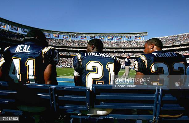 Running backs Lorenzo Neal, LaDainian Tomlinson and Michael Turner of the San Diego Chargers talk on the bench during the game against the Tennessee...