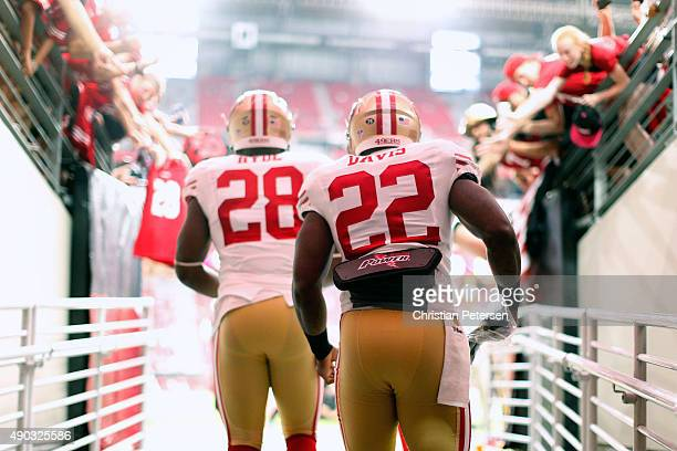 Running backs Mike Davis and Carlos Hyde take the field prior to the NFL game against the Arizona Cardinals at the University of Phoenix Stadium on...