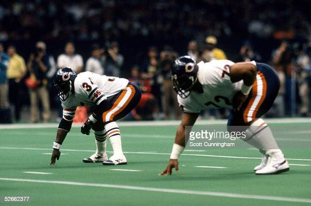 Running Backs Walter Payton and William Perry of the Chicago Bears line up for a play in Super Bowl XX against the New England Patriots at the...