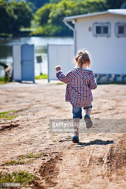 Running boy with long hair