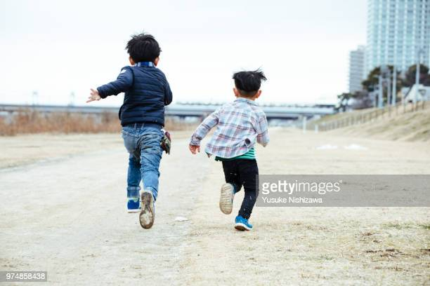 running boys - childhood stock pictures, royalty-free photos & images