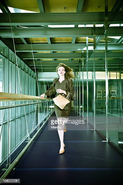 running businesswoman - businesswear stock pictures, royalty-free photos & images