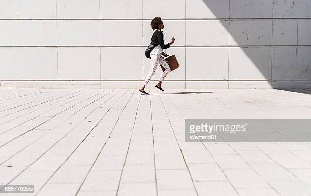 running businesswoman with smartphone and briefcase - beat the clock stock photos and pictures