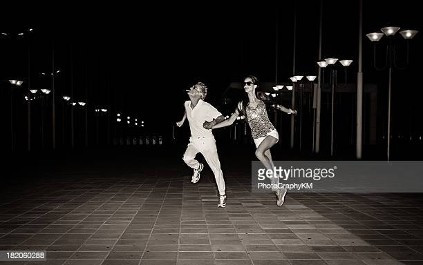 running couple - haute couture stock pictures, royalty-free photos & images