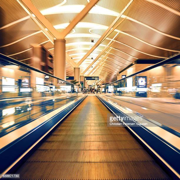 Running down a moving walkway