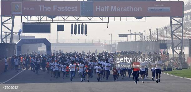 Running enthusiasts participate at Running and Living the fastest half marathon powered by Hindustan Times at the Buddh International Circuit on...
