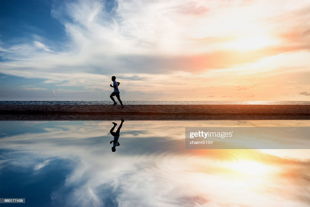Running exercise healthy lifestyle on the summer beach. Exercise health concept. : ストックフォト
