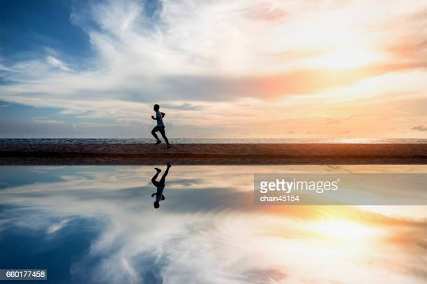 running exercise healthy lifestyle on the summer beach. exercise health concept. - küste stock-fotos und bilder