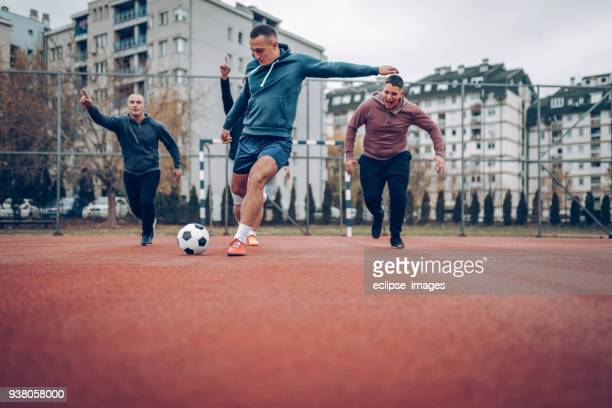 running for a ball - amateur stock pictures, royalty-free photos & images