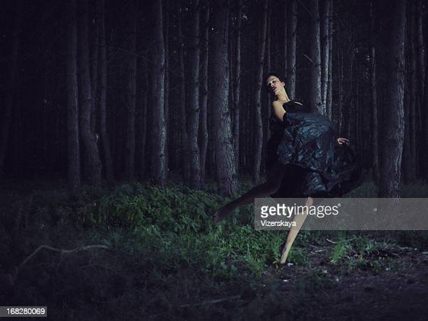 running girl in night forest