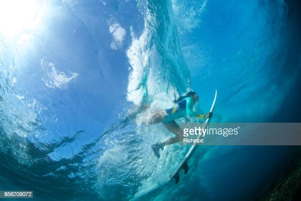 Running girl under a wave