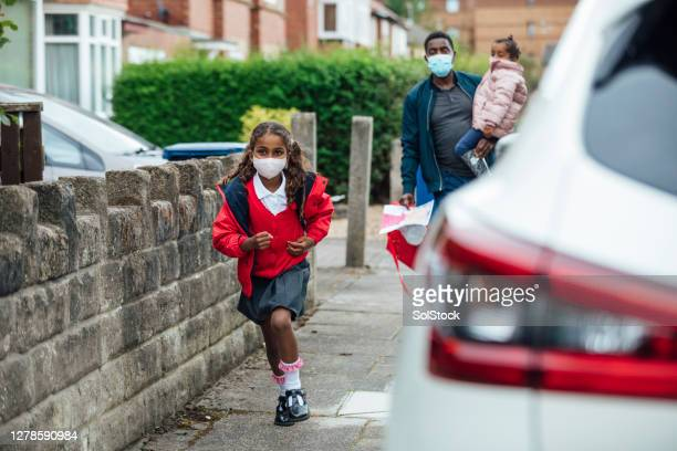 running home from school - school child stock pictures, royalty-free photos & images