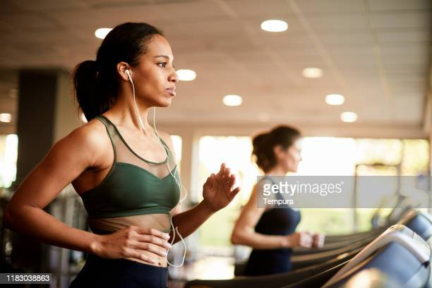 running in a treadmill. - viewpoint stock pictures, royalty-free photos & images