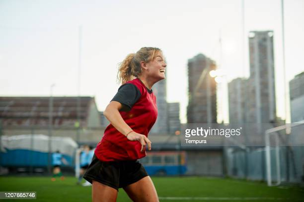 running in celebration after scoring a goal. - disabilitycollection stock pictures, royalty-free photos & images