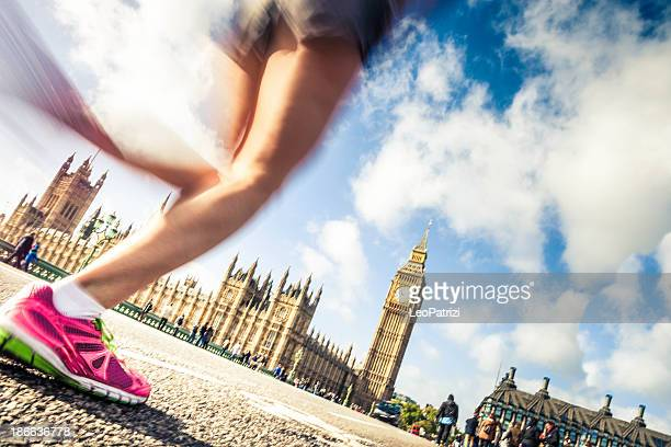 running in london downtown - city of westminster london stock photos and pictures