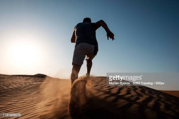 running in the desert - images stock pictures, royalty-free photos & images
