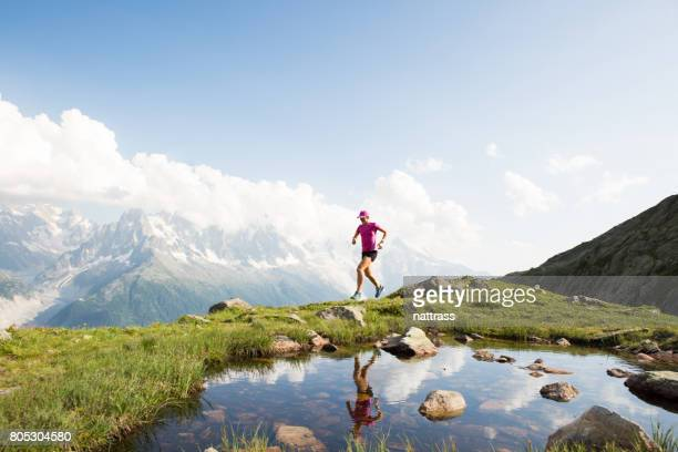 running in the mountains - cross country running stock pictures, royalty-free photos & images