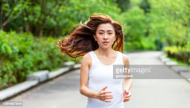 running in the park - taiwan stock pictures, royalty-free photos & images